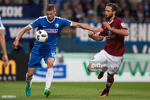 Pawel Dawidowicz of Bochum is challenged by Tim Matavz of Nuernberg during the Second Bundesliga match between VfL Bochum 1848 and 1 FC Nuernberg at...