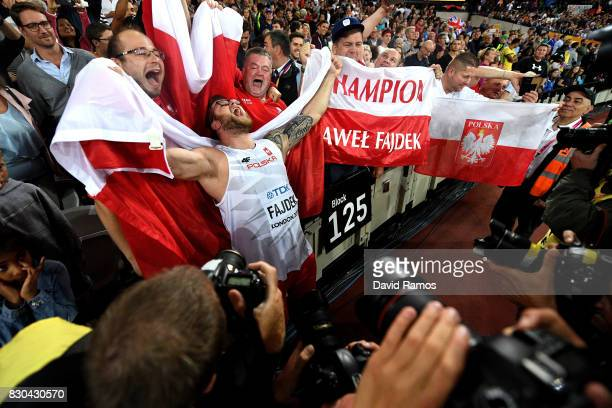 Pawel Fajdek of Poland gold celebrates with the Polish flag after winning the Men's Hammer Throw final during day eight of the 16th IAAF World...
