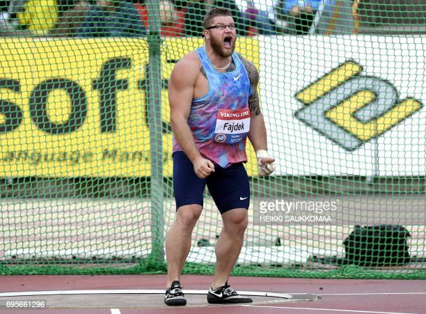 Pawel Fajdek of Poland reacts after competing to set world's stadium lead 8240m in men's hammer competition during the IAAF World Challenge held in...