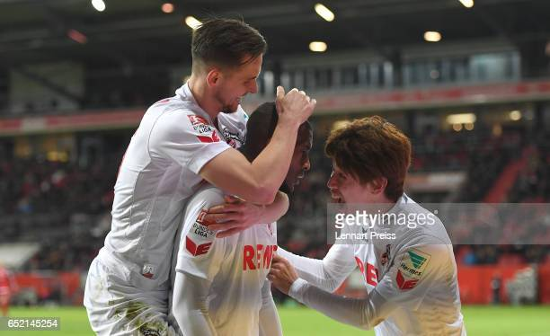 Pawel Olkowski Anthony Modeste and Yuya Osako of 1 FC Koeln celebrate their side's second goal during the Bundesliga match between FC Ingolstadt 04...