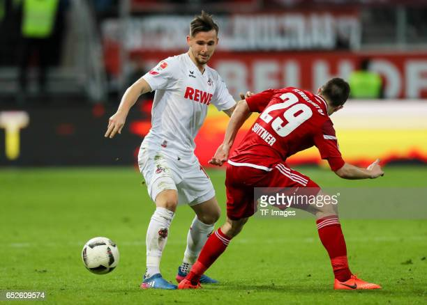 Pawel Olkowski of Cologne and Markus Suttner of Ingolstadt battle for the ball during the Bundesliga match between FC Ingolstadt 04 and 1 FC Koeln at...