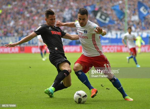 Pawel Olkowski of Cologne is challenged by Filip Kostic of Hamburg during the Bundesliga match between Hamburger SV and 1 FC Koeln at...