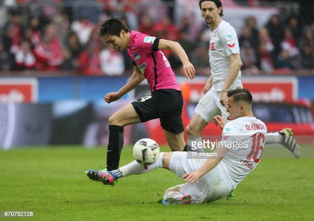 Pawel Olkowski of Colonge and Genki Haraguchi of Berlin battle for the ball during the Bundesliga match between 1 FC Koeln and Hertha BSC at...