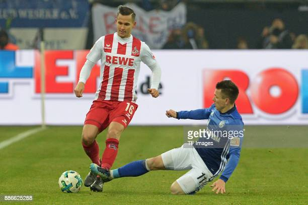 Pawel Olkowski of Koeln and Yevhen Konoplyanka of Schalke battle for the ball during the Bundesliga match between FC Schalke 04 and 1 FC Koeln...
