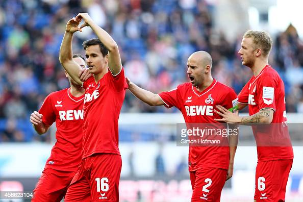Pawel Olkowski of Koeln celebrates his team's first goal with his team mates during the Bundesliga match between 1899 Hoffenheim and 1 FC Koeln at...