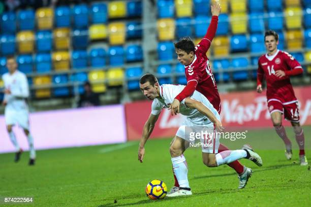 Pawel Tomczyk vies Viktor Tranberg during UEFA U21 Championship Qualifier match between Poland and Denmark on November 14 2017 in Gdynia Poland