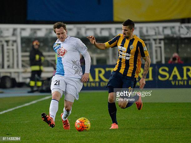 Pawel Wszolek of Hellas Verona competes with Nicolas Freyof Chievo Verona during the Serie A match between Hellas Verona FC and AC Chievo Verona at...