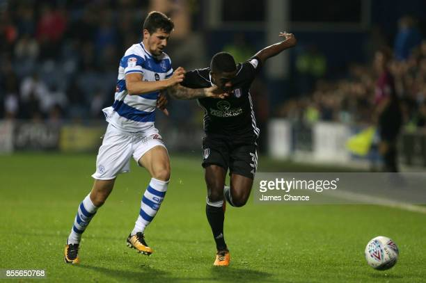 Pawel Wszolek of Queens Park Rangers and Ryan Sessegnon of Fulham battle for possession during the Sky Bet Championship match between Queens Park...