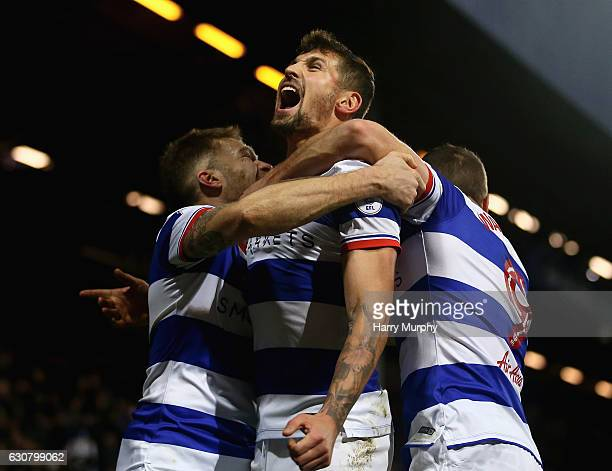 Pawel Wszolek of Queens Park Rangers celebrates scoring his teams second goal with teammates Jamie Mackie and Conor Washington during the Sky Bet...
