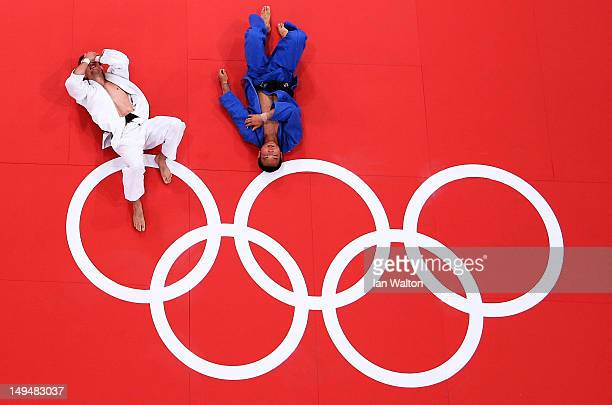 Pawel Zagrodnik of Poland and Masashi Ebinuma of Japan lay on the mat after their match in the Men's 66 kg Judo on Day two of the London 2012 Olympic...