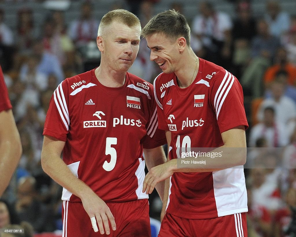 Pawel Zagumny of Poland speaks to his teammate Mariusz Wlazly during the FIVB World Championships match between Australia and Poland on September 2, 2014 in Wroclaw, Poland.