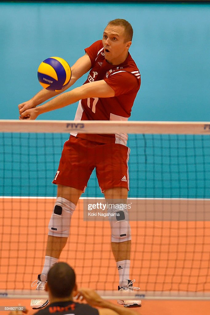 Pawel Zatorski #17 of Poland receives the ball during the Men's World Olympic Qualification game between Poland and Canada at Tokyo Metropolitan Gymnasium on May 28, 2016 in Tokyo, Japan.