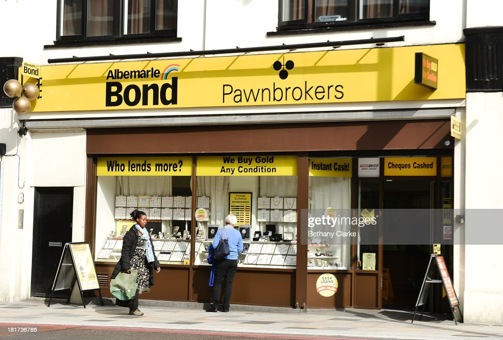 A Pawn Brokers shop on St Johns Road Clapham on September 24, 2013 in London, England. The Labour leader Ed Miliband in his party conference speech has pledged to help small firms by freezing business rates in England. The high street has becoming increasingly full of betting shops, charity shops and pawn brokers replacing independent shops.