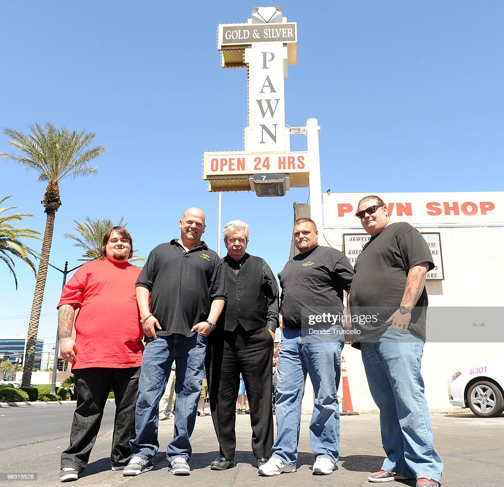 'Pawn Stars' Austin 'Chumlee' Russell, Rick Harrison, Richard Harrison and Corey Harrison (R) pose for photos with 'Ax Men' Gabe Rygaard at Gold and Silver Pawn on April 7, 2010 in Las Vegas, Nevada.