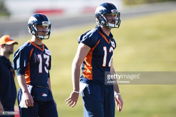Paxton Lynch of the Denver Broncos and Trevor Siemian take their reps during practice at Dove Valley on Wednesday November 22 2017 Paxton Lynch will...