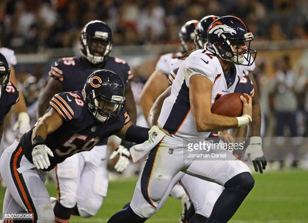 Paxton Lynch of the Denver Broncos breaks away from Jonathan Anderson of the Chicago Bears during a preseason game at Soldier Field on August 10 2017...