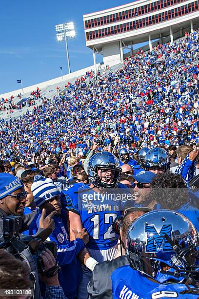 Paxton Lynch of the Memphis Tigers celebrates with fans after a game against the Ole Miss Rebels at Liberty Bowl Memorial Stadium on October 17 2015...
