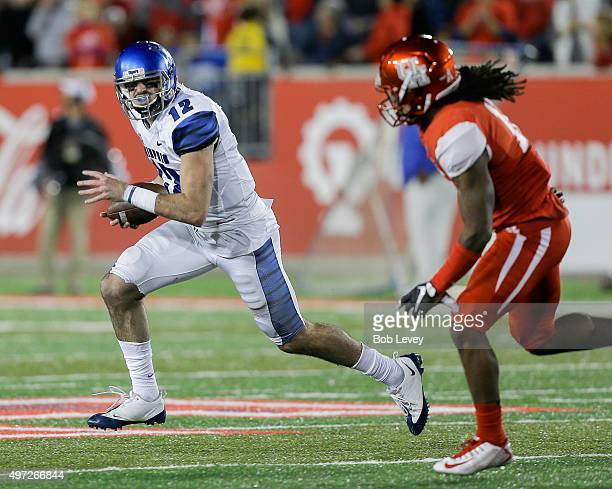 Paxton Lynch of the Memphis Tigers is chased out of the pocket by Houston Cougars at TDECU Stadium on November 14 2015 in Houston Texas