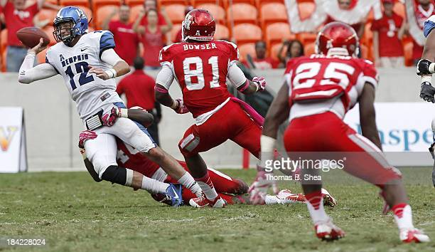 Paxton Lynch of the Memphis Tigers is sacked by Brandon Wilson of the Houston Cougars on October 12 2013 at BBVA Compass Stadium in Houston Texas...