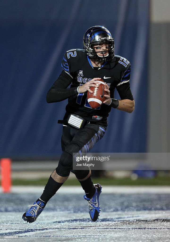 Paxton Lynch #12 of the Memphis Tigers looks to pass against the Cincinnati Bearcats on October 30, 2013 at Liberty Bowl Memorial Stadium in Memphis, Tennessee.