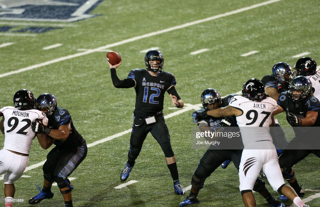 Paxton Lynch #12 of the Memphis Tigers passes against the Cincinnati Bearcats on October 30, 2013 at Liberty Bowl Memorial Stadium in Memphis, Tennessee. Cincinnati beat Memphis 34-21.