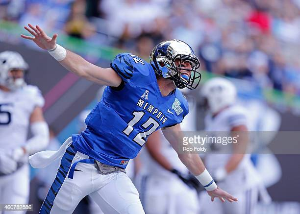 Paxton Lynch of the Memphis Tigers reacts after throwing a touchdown pass during the first quarter of the game against the Brigham Young Cougars at...