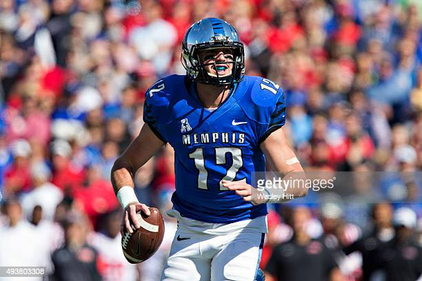 Paxton Lynch of the Memphis Tigers rolls out to pass during a game against the Ole Miss Rebels at Liberty Bowl Memorial Stadium on October 17 2015 in...