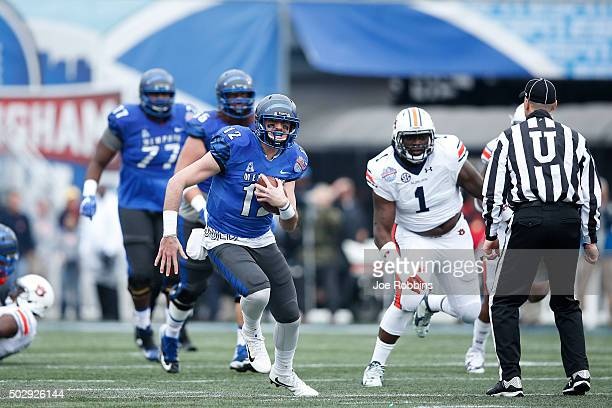 Paxton Lynch of the Memphis Tigers runs with the ball against the Auburn Tigers in the first half of the Birmingham Bowl at Legion Field on December...