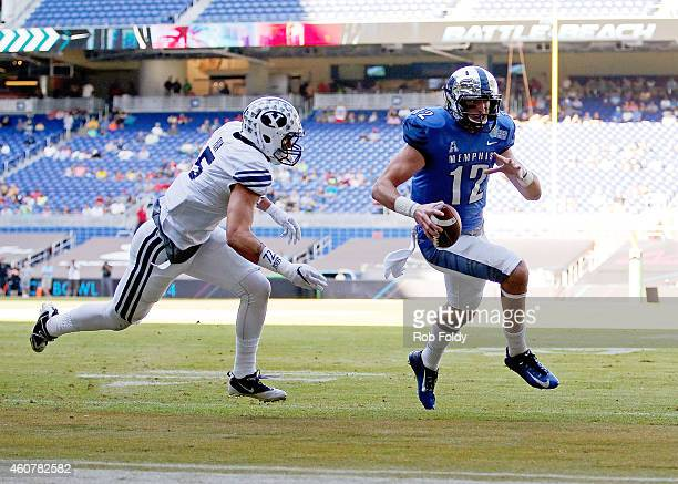 Paxton Lynch of the Memphis Tigers rushes for a touchdown past defender Alani Fua of the Brigham Young Cougar during the first quarter of the game...