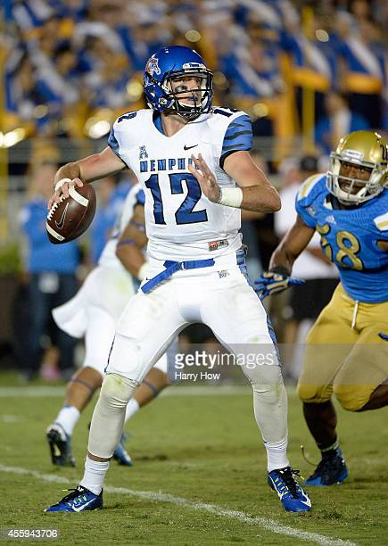 Paxton Lynch of the Memphis Tigers throws as he is rushed by Deon Hollins of the UCLA Bruins at Rose Bowl on September 6 2014 in Pasadena California