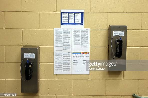 Pay phones for inmates are seen on a wall at the Fremont Police Detention Facility on August 1 2013 in Fremont California The Fremont Police...