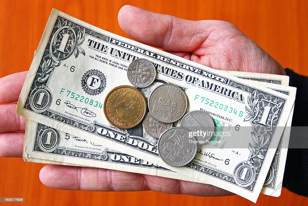Paying Money: USA Dollar Bank Notes and Coins : Stock Photo