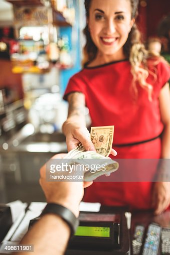paying the bill to the casher