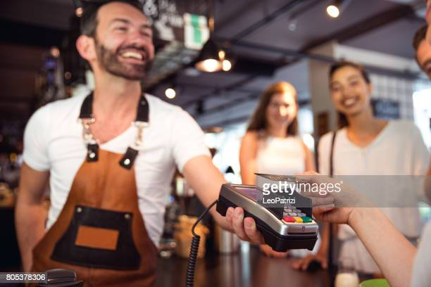 Paying the bill using a contactless credit card