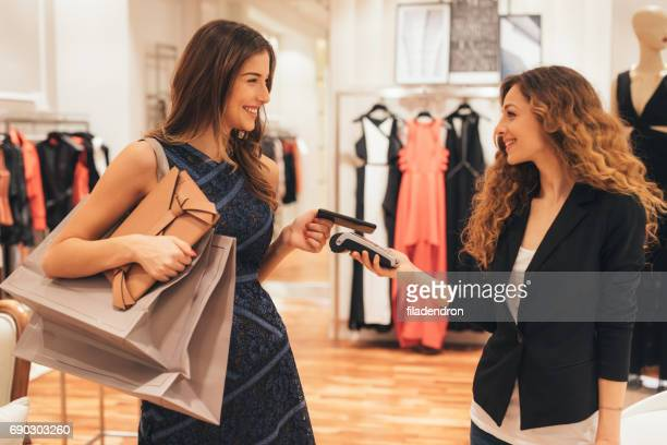 Paying via smart phone at a clothing store