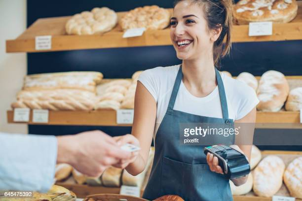 Paying with a credit card in the bakery