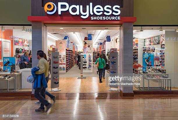Payless Shoe Store Couple walking in a mall corridor
