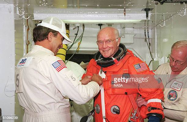 Payload Specialist John H Glenn Jr Senator From Ohio Is Checked By Dave Martin With United Space Alliance And Danny Wyatt Of Ksc Before Entry Into...