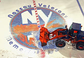 A payloader removes the ice from the Nassau Coliseum on May 5 2015 in Uniondale New York The New York Islanders have played their last game at the...