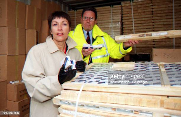 Paymaster General Dawn Primarolo and Alan Wilson head of Customs and Excise AntiSmuggling Eastern Region inspect a haul of 13 million cigarettes...