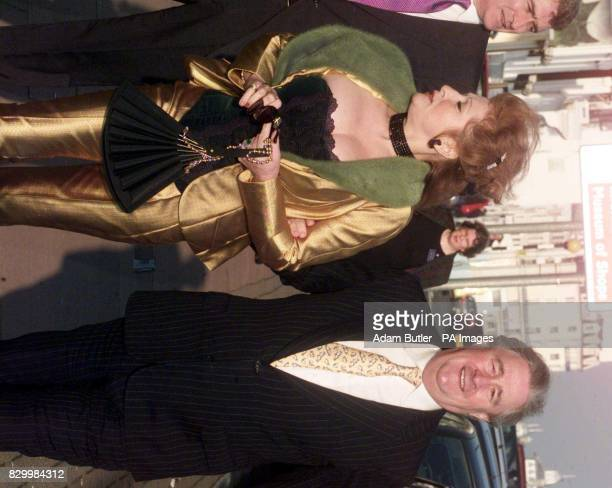 Paymaster General Geoffrey Robinson arrives with his wife MarieElena for the wedding of MP Yvette Cooper to Chancellor Gordon Brown's aide Ed Balls...
