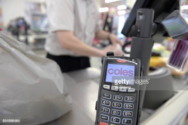 A payment terminal sits at a checkout counter at a Coles supermarket operated by Wesfarmers Ltd in the Richmond area of Melbourne Australia on Friday...