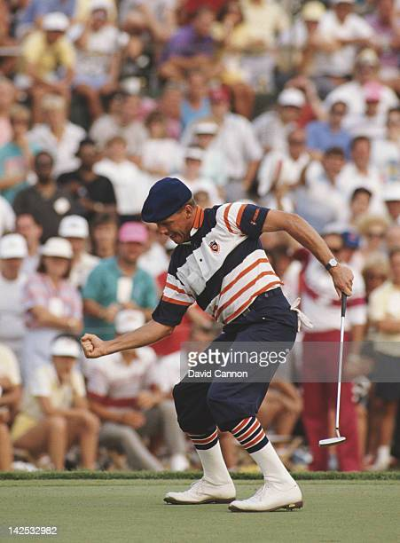 Payne Stewart of the United States celebrates the winning putt on the 18th green to win the US PGA Championship on 13th August 1989 at Kemper Lakes...