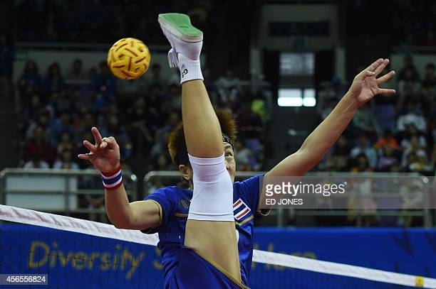 Payom Srihongsa of Thailand jumps for the ball against South Korea during their women's gold medal final event of the 17th Asian Games at the Bucheon...