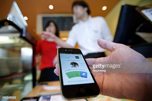 PayPal Inc's mobile payment application on an Apple Inc iPhone is used to purchase coffee during a demonstration at a promotional event at Nestle...