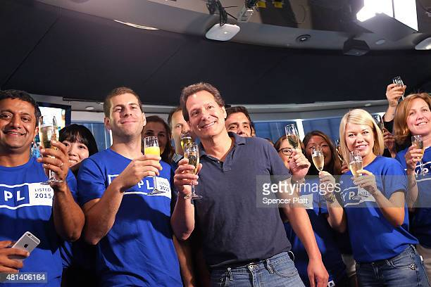 PayPal President and CEO Dan Schulman joins employees and customers after ringing the bell at Nasdaq this morning on July 20 2015 in New York City...
