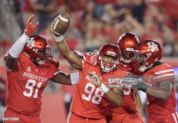 Payton Turner of the Houston Cougars celebrates intercepting a pass against the Rice Owls in the first quarter at TDECU Stadium on September 16 2017...