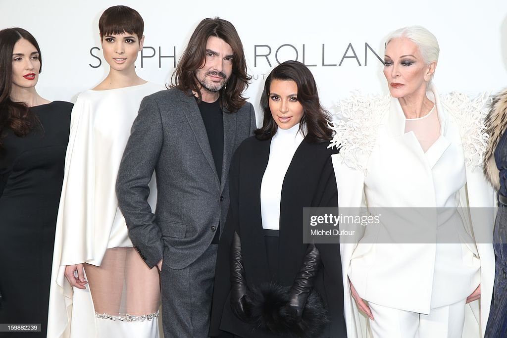 Paz Vega, a model, designer Stephane Rolland, Kim Kardashian and Carmen Dell'Orefice attend the Stephane Rolland Spring/Summer 2013 Haute-Couture show as part of Paris Fashion Week at Palais De Tokyo on January 22, 2013 in Paris, France.