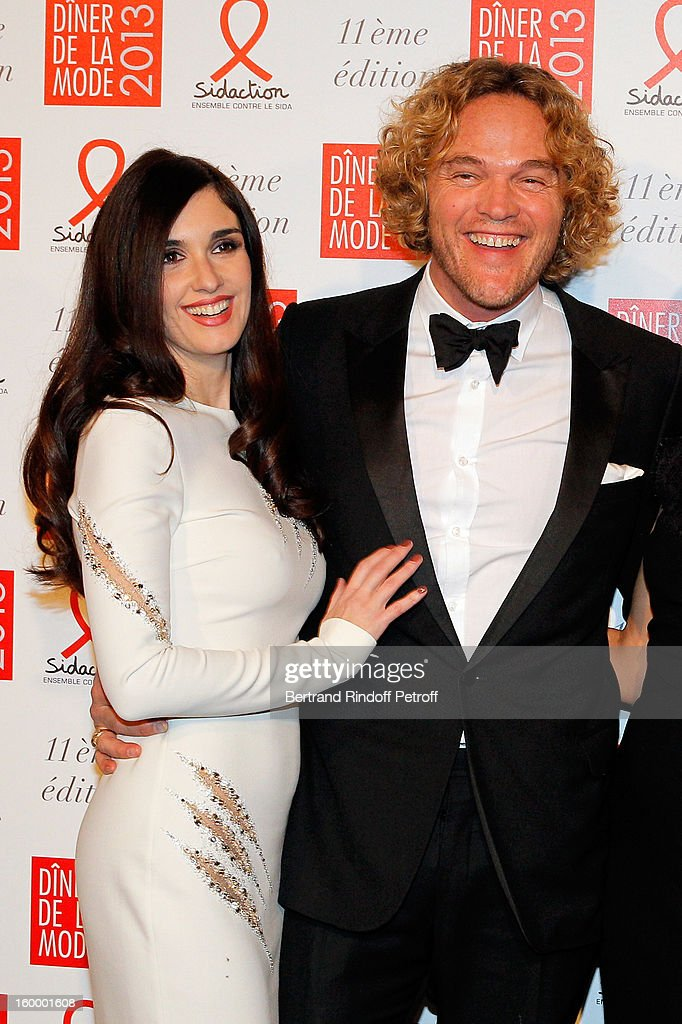 Paz Vega (L) and Peter Dundas pose as they arrive to attend the Sidaction Gala Dinner 2013 at Pavillon d'Armenonville on January 24, 2013 in Paris, France.