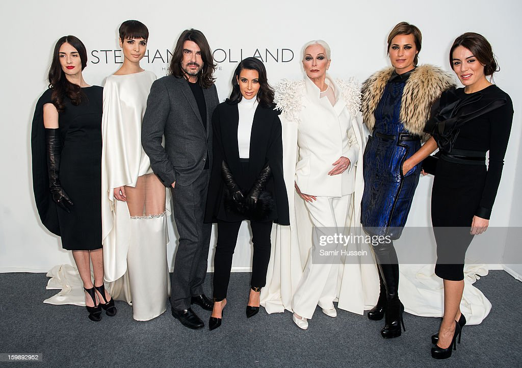 Paz Vega, Hanaa Ben Abdesslem, Stephane Rolland, <a gi-track='captionPersonalityLinkClicked' href=/galleries/search?phrase=Kim+Kardashian&family=editorial&specificpeople=753387 ng-click='$event.stopPropagation()'>Kim Kardashian</a>, <a gi-track='captionPersonalityLinkClicked' href=/galleries/search?phrase=Carmen+Dell%27Orefice&family=editorial&specificpeople=664172 ng-click='$event.stopPropagation()'>Carmen Dell'Orefice</a>, Yasmin Le Bon and Sophia Assaidi pose backstage at the Stephane Rolland Spring/Summer 2013 Haute-Couture show as part of Paris Fashion Week at Palais De Tokyo on January 22, 2013 in Paris France.